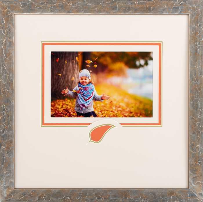 Framed girl playing in leaves